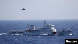 Tàu và trực thăng Trung Quốc trong cuộc diễn tập tìm kiếm cứu hộ tại quần đảo Hoàng Sa, ngày 14/7/2016.