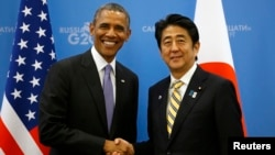 U.S. President Barack Obama (L) shakes hands with Japanese Prime Minister Shinzo Abe at the G20 Summit in St. Petersburg, Russia, Sept. 5, 2013.