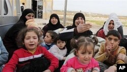 Sirios fugindo de Homs