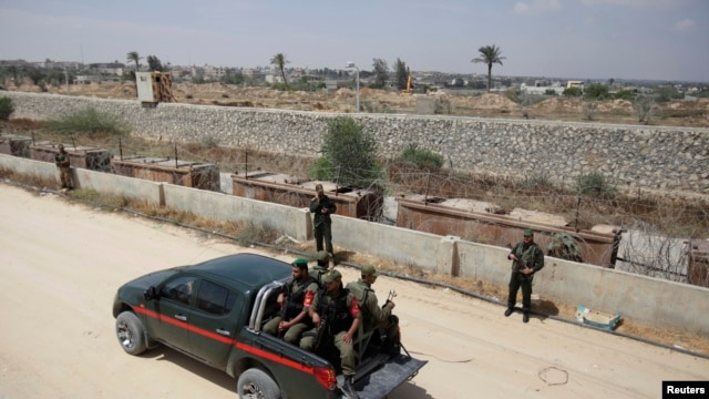 Members of the Hamas security forces ride in a pickup truck as they patrol the border area between Gaza and Egypt, in the southern Gaza Strip, May 20, 2013.