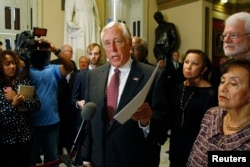 FILE - U.S. House Minority Whip Steny Hoyer speaks to reporters at the Capitol in Washington.