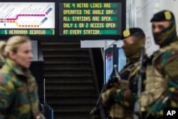 Soldiers patrol at Maelbeek metro station in Brussels, Belgium, April 25, 2016.