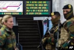 Soldiers patrol at Maelbeek metro station in Brussels, Belgium, April 25, 2016.