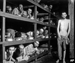 Inmates of the Buchenwald concentration camp are seen inside their barracks a few days after U.S troops liberated the camp near Weimar, Germany in this April 16, 1945 file photo.