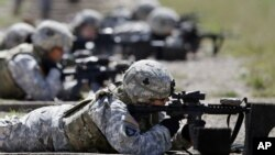 FILE - Coalition forces train at NATO centers in Afghanistan. Islamic State fighters are losing their hold in the country, a United States military spokesman said Thursday.