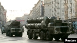 FILE - Russian S-300 anti-missile rocket systems move along a central street in Moscow, May 4, 2009.