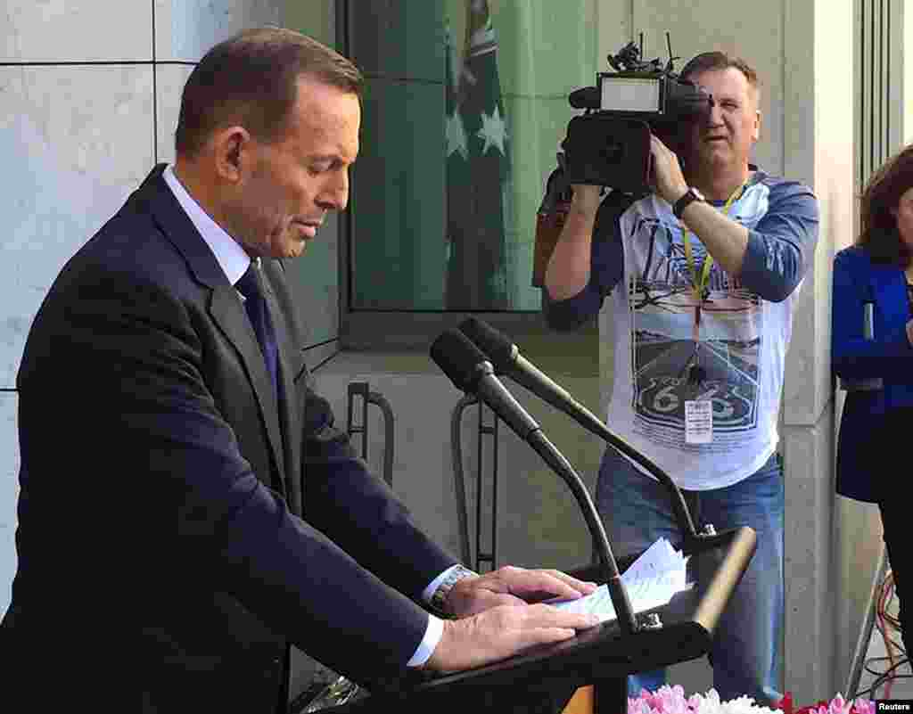 Former Australian Prime Minister Tony Abbott speaks to the media at Parliament House in Canberra, Sept. 15, 2015.