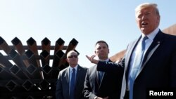 Donald Trump visits section of the border wall in Otay Mesa