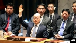 Chinese Ambassador to the United Nations Liu Jieyi votes during a Security Council meeting at U.N. headquarters on a new sanctions resolution that would increase economic pressure on North Korea to return to negotiations on its missile program, Aug. 5, 2017.