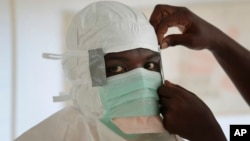 FILE - A nurse gears up to enter a high-risk zone of an Ebola treatment unit run by Doctors Without Borders / Medecins Sans Frontieres in Monrovia, Liberia.
