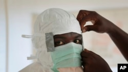 FILE - A nurse gears up to enter a high-risk zone of an Ebola treatment unit run by Doctors Without Borders (Medecins Sans Frontieres) in Monrovia, Liberia.