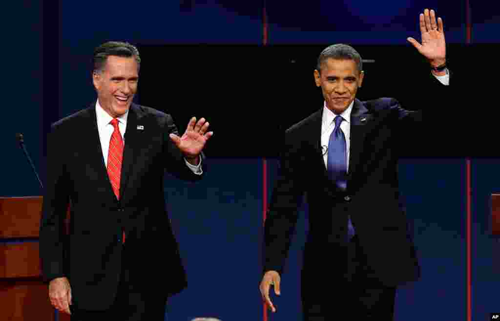 Mitt Romney and President Barack Obama wave to the crowd following the first presidential debate in Denver, Colorado, October 3, 2012