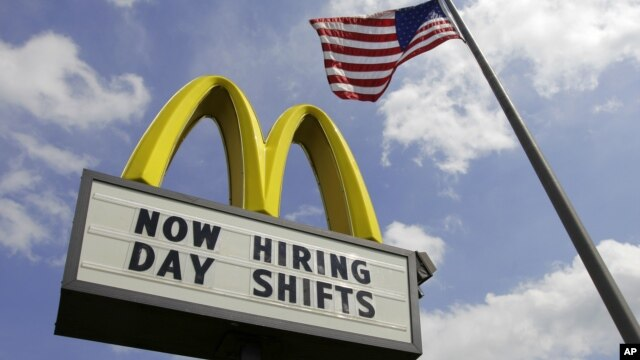 May 2, 2012, file photo shows a sign advertising job openings outside a McDonald's restaurant in Chesterland, Ohio.