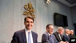 FILE - New president of the Institute of Religious Works, or IOR (Vatican bank), Jean-Baptiste de Franssu, left, July 9, 2014.