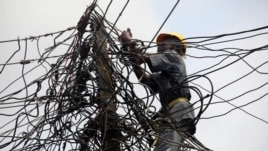 Nigeria Power employee works on a tangle of lines, Lagos, July 22, 2011.