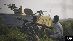 Xe bọc thép của Lực lượng Liên Hiệp Châu Phi (AMISOM) tiến về vị trí của phiến quân al-Shabab trong thủ đô Somalia, ngày 21/1/2012
