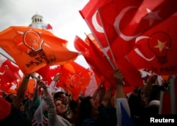 People wave flags during Turkey's Prime Minister Tayyip Erdogan speech at his rally in Ankara, June 15, 2013.