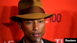 FILE - Pharrell Williams arrives at the Time 100 gala celebrating the magazine's naming of the 100 most influential people in the world for the past year, in New York, April 29, 2014.