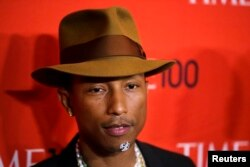 Honoree and singer Pharrell Williams arrives at the Time 100 gala celebrating the magazine's naming of the 100 most influential people in the world for the past year, in New York April 29, 2014.