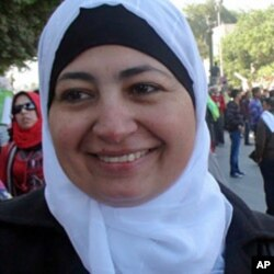 Salwa, a mother of four, celebrates on Tahrir Square one week after a popular uprising ushers in a new era in Egyptian politics, February 18, 2011