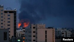 Dim i plamen iznad zgradau Gazi, 20. maj 2021. godine.