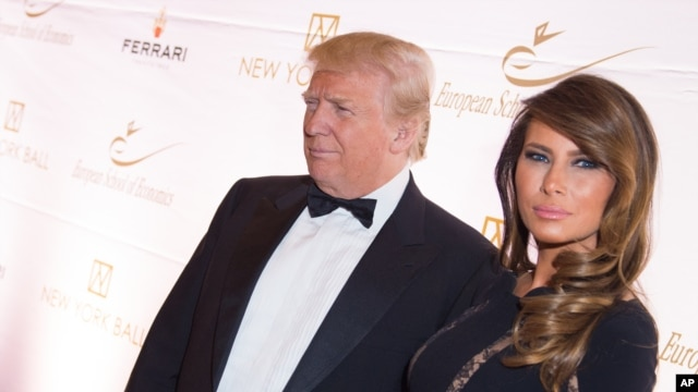 FILE - Donald Trump and Melania Trump attend a benefit at Trump Tower in New York, Nov. 19, 2014.