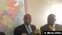 Visiting United Nations' Assistant Secretary-General for Political Affairs Tayé-Brook Zerihoun (left) speaks on reporters in Harare 20 June 2018 while Zimbabwe Foreign minister Sibusiso Moyo looks on.