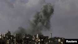 Smoke rises over the Salah al-Din neighborhood in central Aleppo, Syria, March 2, 2013.