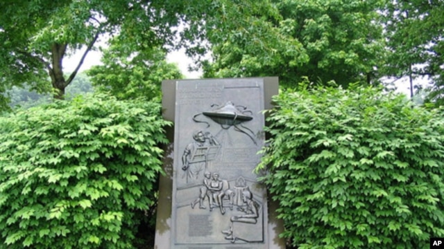 In the fictional 'War of the Worlds,' Martians land in the New Jersey town of Grover's Mill.  Years later, somebody put up this monument at the site, which is now part of a larger town.