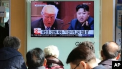 "People watch a TV screen showing images of U.S. President Donald Trump, left, and North Korean leader Kim Jong Un at the Seoul Railway Station in Seoul, South Korea, Tuesday, Nov. 21, 2017. Trump announced Monday the U.S. is putting North Korea's ""murderous regime"" on America's terrorism blacklist, despite questions about Pyongyang's support for international attacks beyond the assassination of its leader's half brother in February. The signs read ""UN sanctions and The blow is not big."" (AP Photo/Ahn Young-joon)"