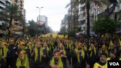 Xwepêşandineke alîgirên Hizbullah li başûrê Beyrûtê. (arşîv)