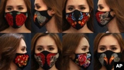 These Wednesday, April 15, 2020,combination photos, shows a woman wearing designs of embroidery masks at a fashion studio in Hanoi, Vietnam. (AP Photo/Hau Dinh)