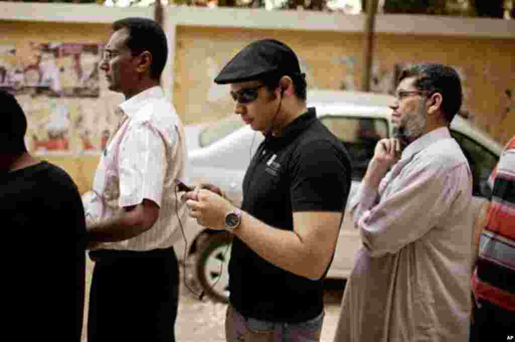 Ahmed Maher, a co-founder of the April 6 Revolutionary Movement, waits in line to vote at a polling center in Maadi, a southern suburb of Cario, Egypt on Wednesday, May 23, 2012. The April 6 Movement was one of the leading youth protest movements during t