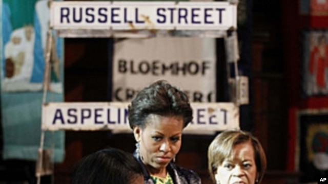 U.S. first lady Michelle Obama (C) and her mother Marian Robinson (R) listens to Bonita Bennett, director, as they visit the District Six museum, in Cape Town, South Africa, June 23, 2011