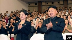 Photo released on July 9, 2012 shows North Korean leader Kim Jong Un and Ri Sol Ju during a musical performance in Pyongyang. (KCNA)