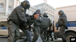 Russian police detain a participant during an opposition rally protesting Vladimir Putin's presidential victory, in St. Petersburg, March 5, 2012.