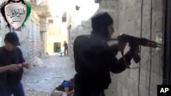 In this image taken from video obtained from the Ugarit News, which has been authenticated based on its contents and other AP reporting, Syrian rebels clash with government forces in Damascus, Syria, May 3, 2013.