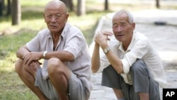 Elderly Chinese men relax in park, Beijing, China
