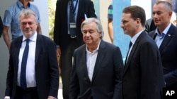 U.N. Secretary-General Antonio Guterres, center, arrives to a press conference at the U.N. Aleppo Elementary school in Beit Lahiya, Gaza Strip, Wednesday, Aug. 30, 2017. Gaza's Hamas rulers welcomed U.N. Secretary-General Antonio Guterres to the isolated territory Wednesday by demanding he work to lift the Israeli-Egyptian blockade of the strip and save it from a humanitarian crisis.