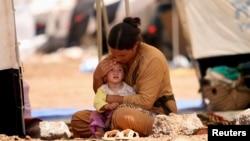 成千上万的伊拉克北部民众为躲避战乱逃离家园(20148月17日)