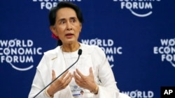 Aung San Suu Kyi, the State Counsellor of Myanmar, gestures during a one-on-one discussion with Berge Brende at the World Economic Forum's meeting at the National Convention Center, Sept. 13, 2018 in Hanoi, Vietnam. Suu Kyi said the country's handling of its Rohingya Muslim minority crisis could have been better.