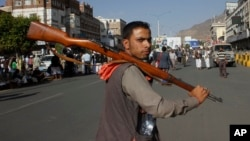 A Houthi Shi'ite rebel joins protests against Saudi-led airstrikes at a rally in Sana'a, Yemen, April 1, 2015. The air raids hit Shi'ite rebel positions in both north and south Yemen.