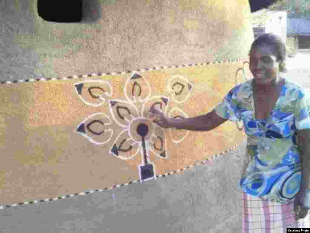 A woman decorating her hamlet in Matobo district, Matabeleland South Province