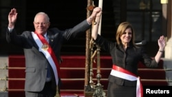 Peru's President Pedro Pablo Kuczynski and new Prime Minister Mercedes Araoz gesture during her swearing-in ceremony at the government palace in Lima, Peru, Sept. 17, 2017.