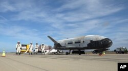 his undated photo provided by the U.S. Air Force shows an X-37B Orbital Test Vehicle at NASA's Kennedy Space Center in Florida. An unmanned Falcon rocket that carried one of these experimental planes blasted off Thursday, Sept. 7, 2017.