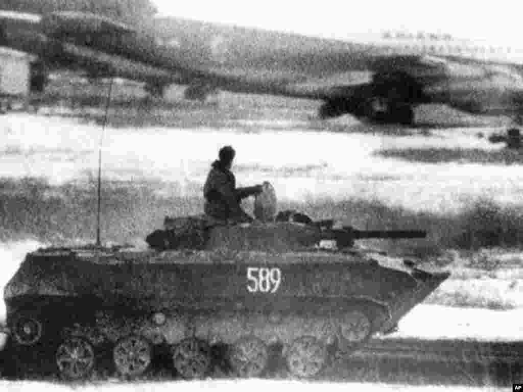 December 1979: Soviet troops invade Afghanistan to help the country's communist government fight mujahedeen guerrilla forces. (AP)