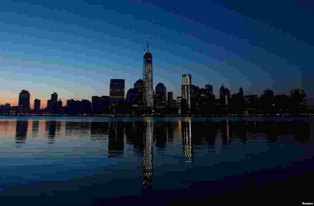 One World Trade Center in New York is reflected in the Hudson River as seen from Jersey City, New Jersey, May 10, 2013.