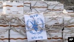 عقد قرار داد توزیع کارت های کوپن به خانواده های مستضعف افغان