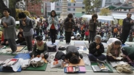 South Korean parents pray during a special service to wish for their children's success on the College Scholastic Ability Test