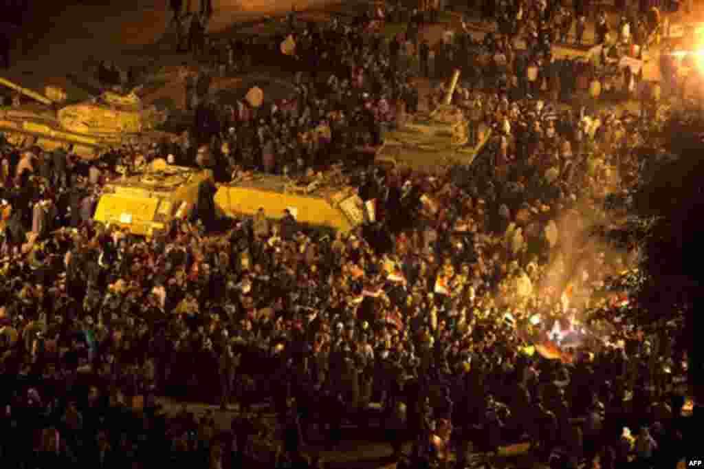Anti-government protesters celebrate in Tahrir Square in downtown Cairo, Egypt Thursday, Feb. 10, 2011. Egypt's military announced on national television it had stepped in to secure the country and promised protesters calling for President Hosni Mubarak's